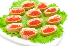 Tartlets with red caviar on white background Stock Photography