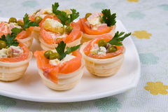 Tartlets with red fish Stock Images