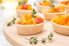 Tartlets with roasted vegetables and thyme Stock Photo
