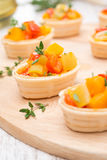 Tartlets with roasted vegetables and thyme Stock Image