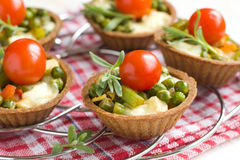 Tartlets with roasted vegetables Stock Images