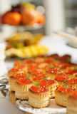 Tartlets with salmon caviar Stock Photos