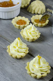 Tartlets. Set of tasty tartlets with apricot jam and whipped cream Stock Images