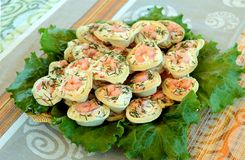 Tartlets with shrimp. Tartlets stuffed with dill, lettuce, peppers and cheese Royalty Free Stock Image