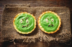 Tartlets with spinach cream for Halloween in the form of a monst Royalty Free Stock Photography