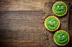 Tartlets with spinach cream for Halloween in the form of a monst Stock Photo