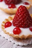 Tartlets with strawberries, cranberries and cream Stock Photo