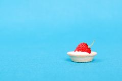 Tartlets with strawberry and cream on a blue background, side vi Royalty Free Stock Photography