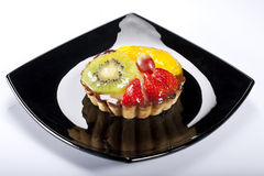 Tartlets with sweet fruits Stock Photos