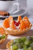 Tartlets with tangerine, cranberry and coffee Stock Photography