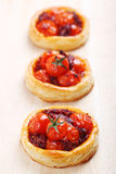 Tartlets with tomato Stock Images