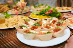 Tartlets on a tray. In a restaurant Stock Images