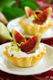 Tartlets with whipped cream Stock Images