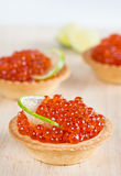 Tartlets With Red Caviar And Lime Royalty Free Stock Photo