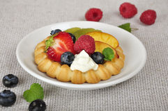 Tarts with berries. Cottage cheese cream tarts with a slices of berries and fruits Stock Photos