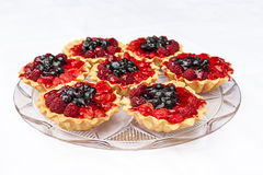 Tarts with berries on white background Stock Images