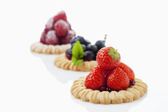 Tarts with blueberries, strawberries and raspberries. On white  background Stock Photo