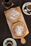 Tarts cakes with coffee. On dark wooden board Stock Photos