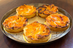 Tarts on  a copper plate Stock Photos