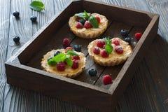 Tarts with fresh berries Stock Photo