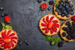 Tarts with lemon cream and fresh berries Stock Photos