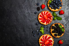 Tarts with lemon cream and fresh berries Stock Image