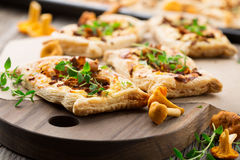 Tarts of puff pastry with mushrooms Stock Photography