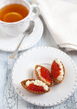 Tarts with red caviar Stock Images