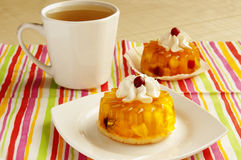 Tarts with whipped cream and a cup of tea Royalty Free Stock Photography