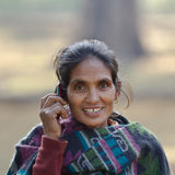 Taru ethnic woman talking with mobil phone in Nepal Royalty Free Stock Photo