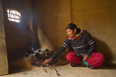 Taru nepali woman cooking in traditional kitchen Royalty Free Stock Image