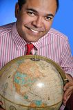 Tarvel agent. This picture represents a travel agent holding a world global Stock Photography