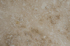Tarvertine Tile Close Up. Travertine tile close up background image with brown and cream swirls royalty free stock image