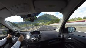Tarvisio motorway, Italy. Driving shot, passenger point-of-view. Time lapse driving on highway. Summer time stock video footage