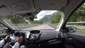 Tarvisio motorway, Italy. Driving shot, passenger point-of-view. Time lapse driving on highway. Summer time stock footage