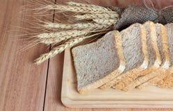 Tarwe, brood en tarwemeel Stock Afbeelding