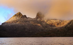 Tas Cradle Mount Lake rise. Australia Tasmania Cradle Mountain national park and main landmark close up view at sunrise illuminated by sun light clouds Royalty Free Stock Photos