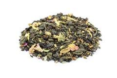 Tas de thé lâche biologique de flower power sur le blanc photo libre de droits