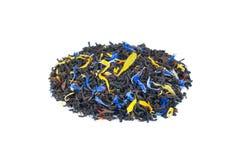 Tas de thé rêveur exotique lâche coloré sur le fond blanc photo libre de droits