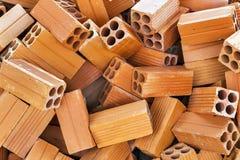 Tas des matériaux de construction de fond de briques Images stock