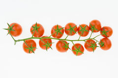 Tas des tomates-cerises, sur le blanc Photographie stock libre de droits