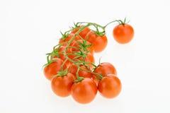 Tas des tomates-cerises, sur le blanc Photo libre de droits