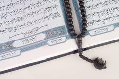 Tasbih (beads) on Holy Quran Stock Photo