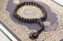 Tasbih (beads) on Holy Quran Stock Images