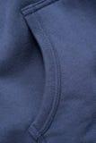 Tasca blu della maglietta felpata Fotografia Stock Libera da Diritti