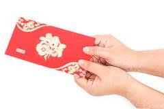 Tasca rossa e soldi fortunati sul nuovo anno cinese Fotografia Stock Libera da Diritti