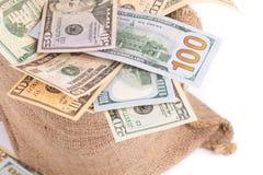 Tasche mit vielem Geld Lizenzfreie Stockfotos