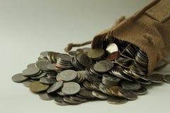 Tasche von thailändischen Münzen Stockfotografie