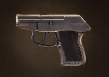 Taschen-Pistolen-Gewehr Keltec P-32 auf Grundge Backgroun Stockbild