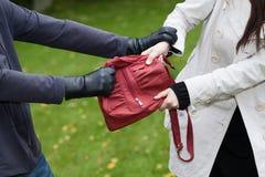 Taschendiebstahl Lizenzfreie Stockbilder